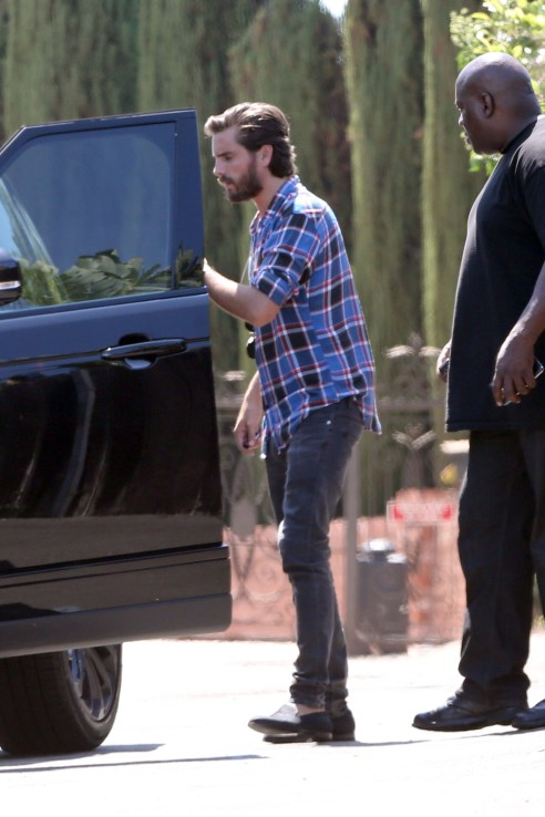Scott Disick is spotted getting into his car with son Mason and Reign
