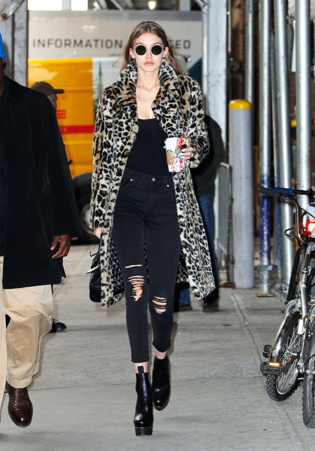 Gigi Hadid out and about in New York wearing aleopardcoat