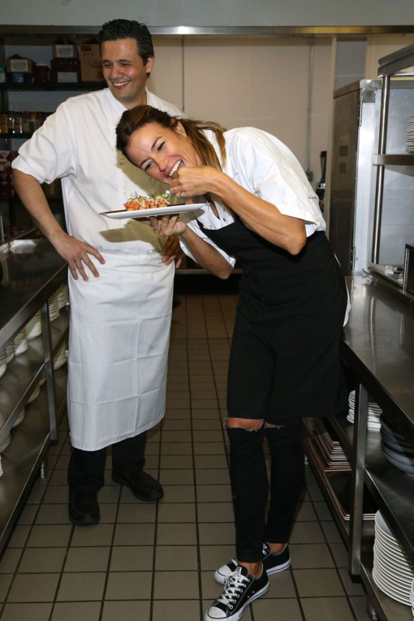 Kelly Bensimon Getting a Cooking Lesson At Kola House Restaurant