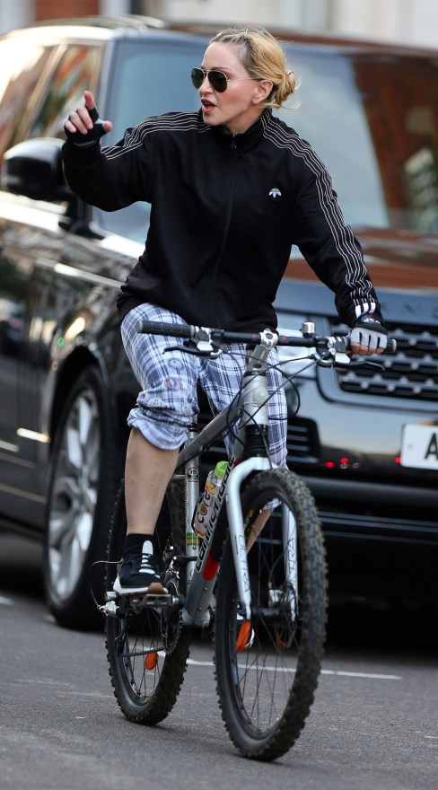 EXCLUSIVE: A low rider Madonna out cycling in London.