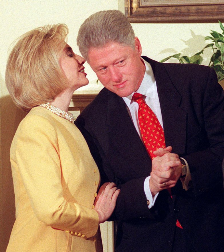 US President Bill Clinton (R) listens to his wife