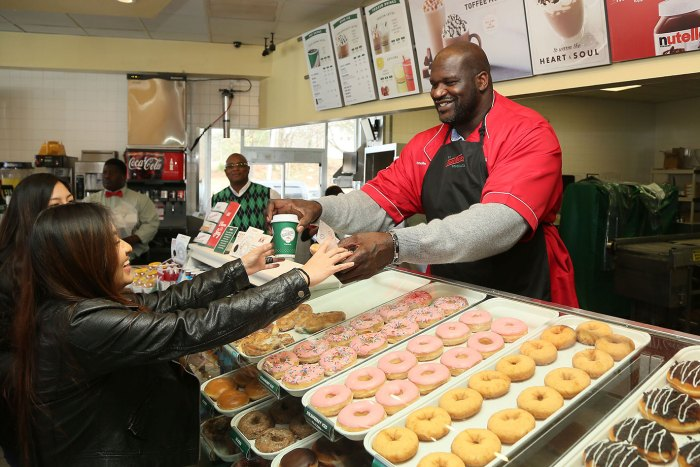 Shaquille O`Neal serves Krispy Kreme`s All-New Freshly Brewed Coffee at the Store He Owns