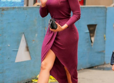 Jordin Sparks looks stunning in a plum high low knit dress while out and about in New York City