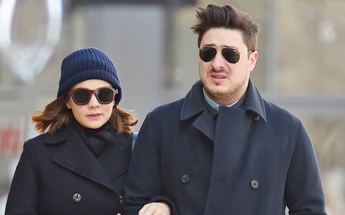 Carey Mulligan and Marcus Mumford walk arm in arm in matching navy coats as they stroll though SoHo in NYC