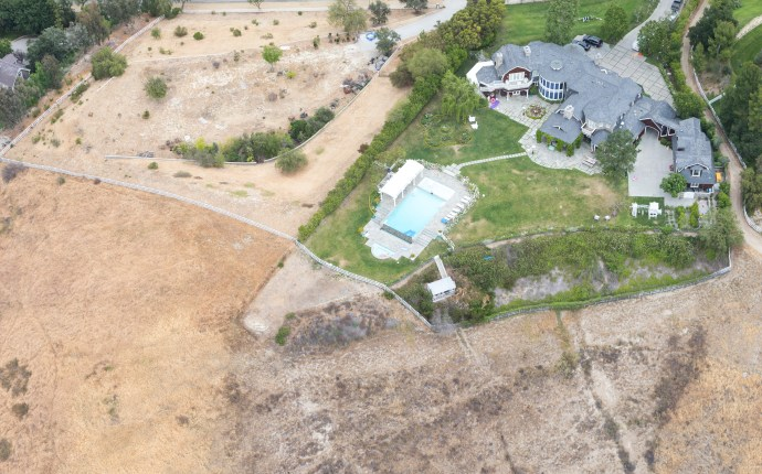 EXCLUSIVE: ** PREMIUM RATES APPLY ** The green watered lawns of Hollywood's A listers during CA's worst drought on record.