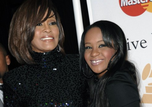 Late mother Whitney Houston and Bobbi Kristina Brown. (Photo credit: AP Photo/Dan Steinberg, File)