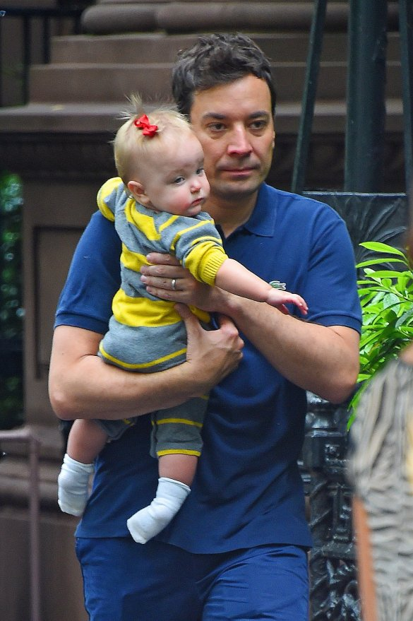 Jimmy Fallon carries his daughter Winnie as he leaves his apartment with wife Nancy_ NYC