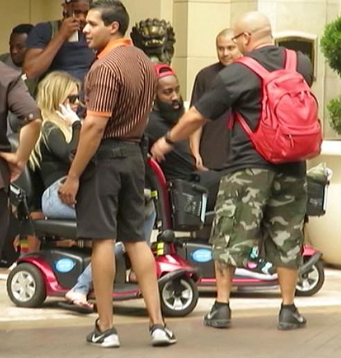 Khloe Kardashian and James Harden ide motor carts together while leaving their Las Vegas luxury hotel together on July 4 weekend. (Photo credit: Splash)