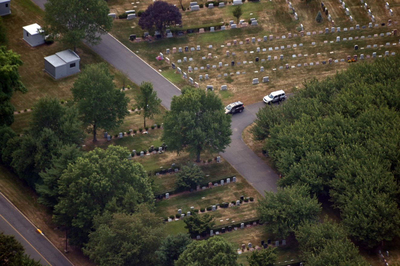 EXCLUSIVE: Aerial view of security outside of Whitney's and Bobbi Kristina's Grave in NJ