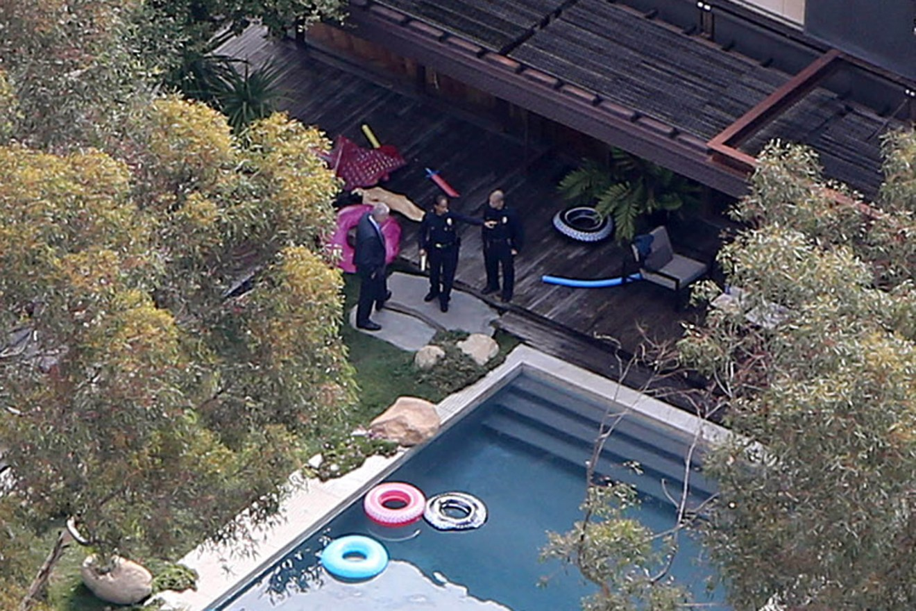 EXCLUSIVE: ** PREMIUM RATES APPLY** Police are seen at the house of Demi Moore where a man was found dead in the pool in Los Angeles,California.