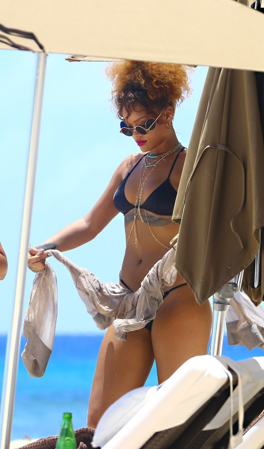 EXCLUSIVE: **NO WEB UNTIL 4PM GMT AUGUST 11TH**PREMIUM RATES APPLY**STRICTLY NO SUBSCRIPTIONS** Singer Rihanna is spotted dancing and drinking beer on the beach with friends and family while on holidayinBarbados