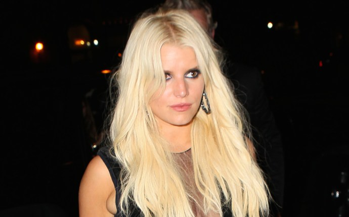INF   Jessica Simpson Flashes Major Cleavage in Sheer Deep V Jumpsuit