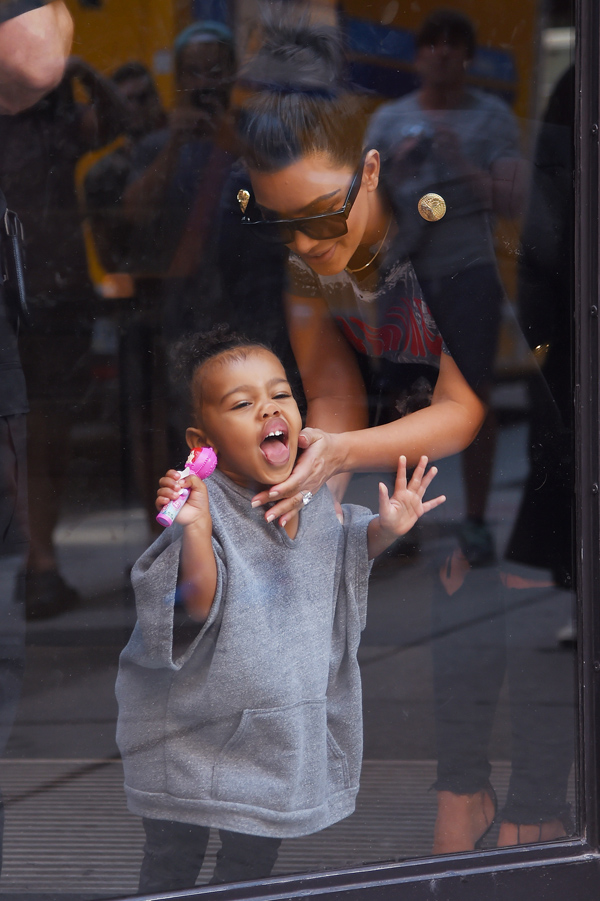 North West makes faces and licks the window at the Milk Studios as her and mom Kim Kardashian wait for their car, NYC Pictured: North West, Kim Kardashian  Ref: SPL1119221  070915   Picture by: Splash News Splash News and Pictures Los Angeles:310-821-2666 New York:212-619-2666 London:870-934-2666 photodesk@splashnews.com