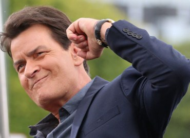 Charlie Sheen looks animated as he interviews for Extra at Universal Studios in Hollywood!