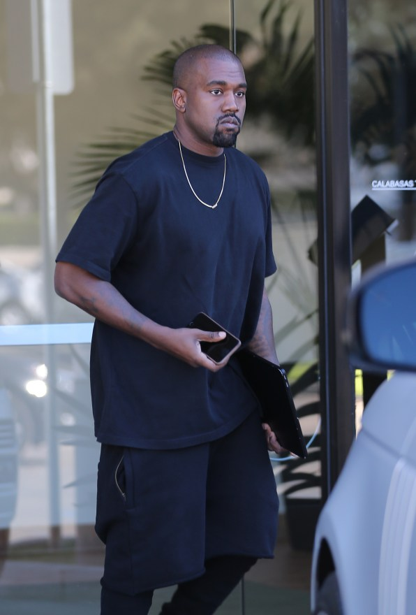Kanye West gets dropped off at his office by Kim Kardashian