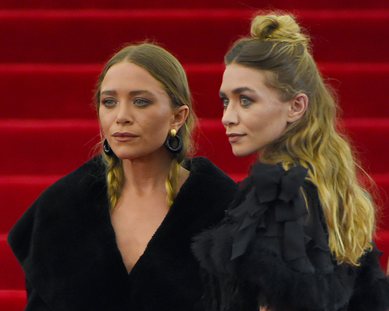 Mary-Kate and Ashley Olsen arrive at the 2015 Met Gala inNewYorkCity