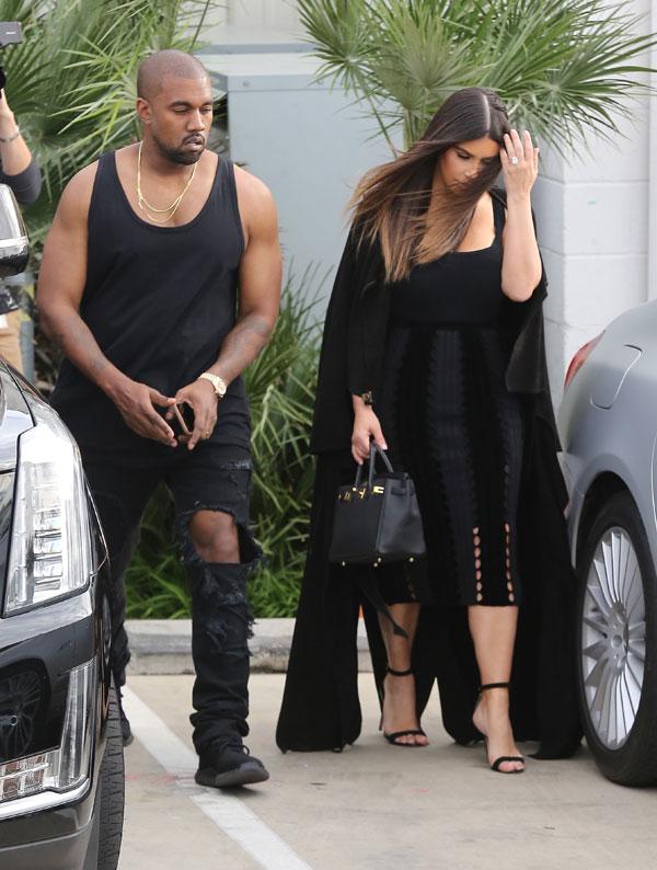 kim-kardashian-buys-car-kanye-west-financial-crisis-04