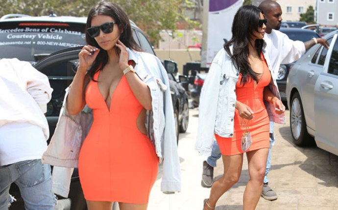 kim kardashian orange dress date night kanye west