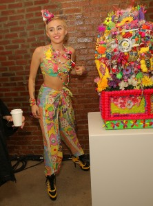 NEW YORK, NY - SEPTEMBER 10: Miley Cyrus poses baskstage at Jeremy Scott fashion show during MADE Fashion Week Spring 2015 at Milk Studios on September 10, 2014 in New York City. (Photo by Chelsea Lauren/Getty Images)