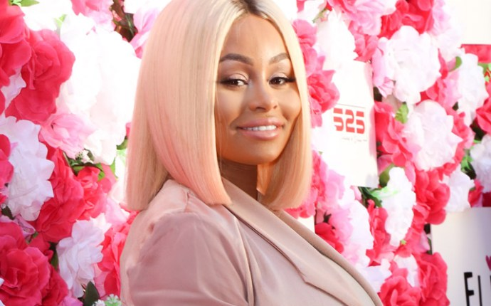 Blac Chyna shows off her baby bump on the pink carpet at the Amber Rose Slutwalk in Los Angeles, CA