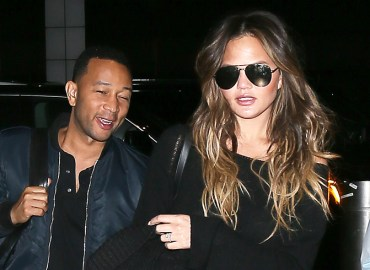 Chrissy Teigen and John Legend at JFK airport.