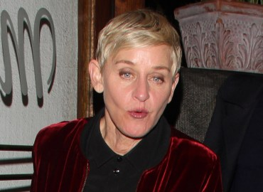 Ellen DeGeneres celebrates with Portia de Rossi after the People's Choice Awards