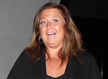 Abby Lee Miller can't contain her smile as she leaves dinner at Craig's