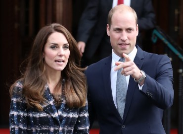 Kate Middleton and Prince William greet their fans as they leave the Manchester Town Hall