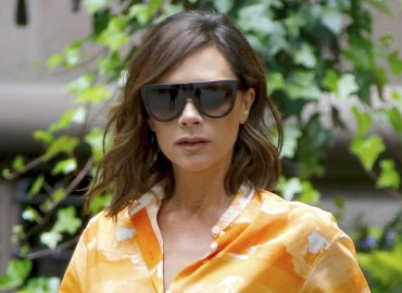 Victoria Beckham steps out in a lovely orange dress with maroon heels