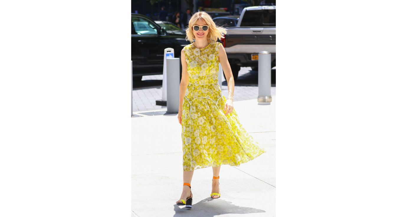 Naomi Watts embraces the days sunny weather in bright yellow dress