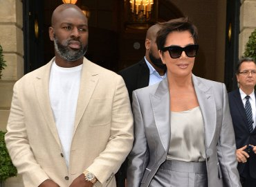 Kris Jenner silver suit and Corey Gamble khaki outfit