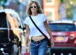 Meg Ryan wearing low rise jeans and crop top
