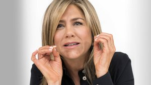 Jennifer Aniston Making Hand Gestures Wearing Black Shirt With White Buttons