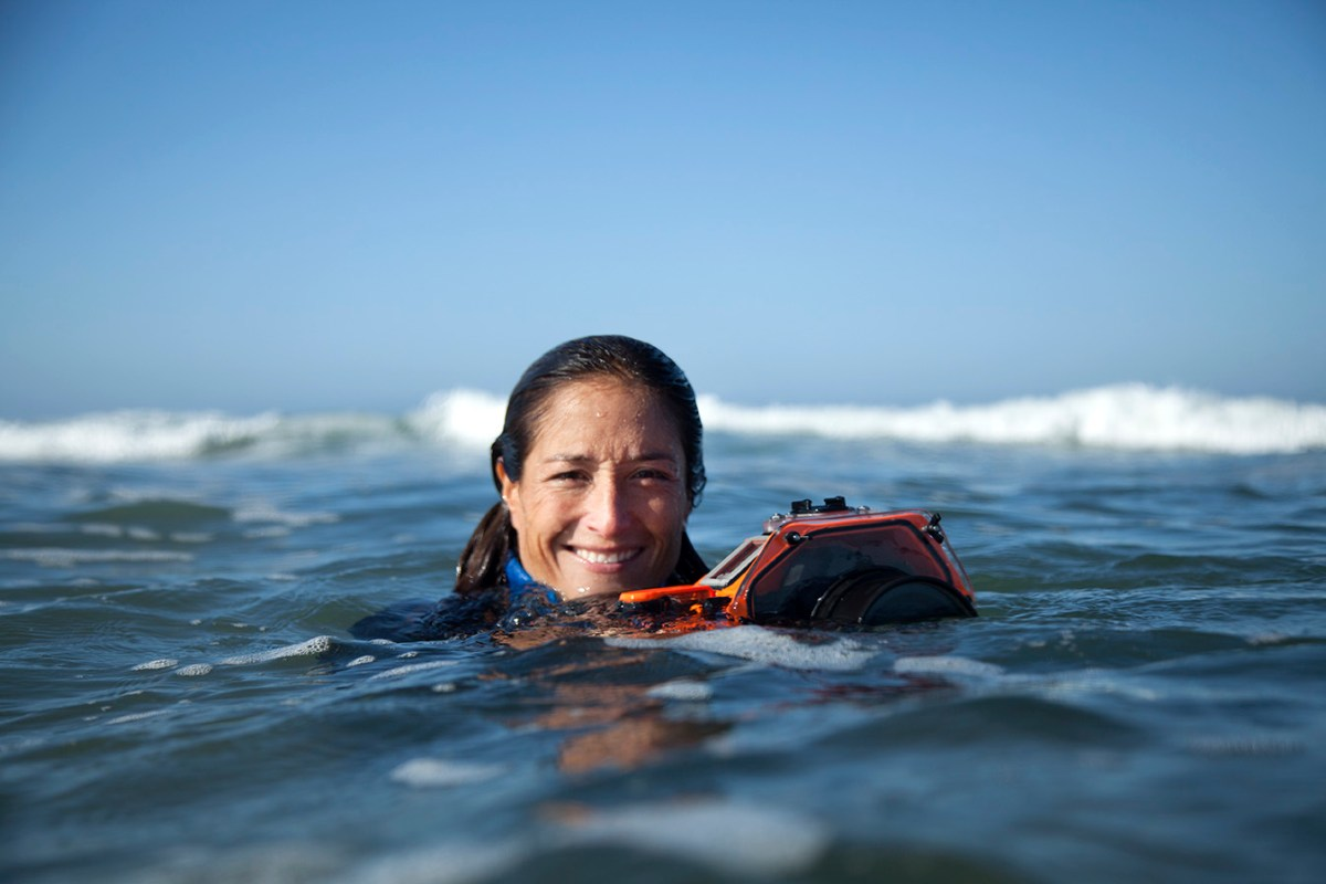 """SACHI CUNNINGHAMIn the foggy, sharky lineups at Mavericks and Ocean Beach is where you'd least expect to find a smiling swimmer, but that's where Sachi Cunningham thrives. The San Francisco-based photographer has always loved big waves, and for the last six years has focused her lens on the women currently pushing the limits in big-wave surfing. """"SheChange,"""" a documentary she's currently working on, follows Andrea Moller, Bianca Valenti (below), Paige Alms and Keala Kennelly and their fight for gender equality in surfing.Cunningham is also an associate professor of journalism at San Francisco State University, a career that has enabled her to focus on the joy of storytelling without the pressure of making surf photography her main source of income. """"I used to be very focused on becoming a 'professional' water photographer, getting paid to live the dream,"""" says Cunningham. """"But some of the barriers that existed when I was coming up over two decades ago…meant that I had to develop a lot of marketable skills beyond water photography to pay the rent.""""Cunningham turned these limitations into strengths. """"It gave me the freedom to take risks with my passion for water photography that have been critical to my development. I think I had to overcome my fantasy of what I thought being a successful water photographer was in order to find and develop my own path and creative voice."""""""